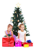 Sisters at Christmas tree Royalty Free Stock Images