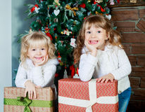 Sisters with Christmas tree Royalty Free Stock Image
