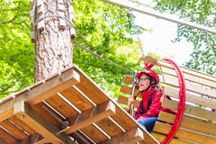Sisters climbing in high rope course together Stock Photo
