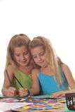 Sisters coloring vertical. Isolated on a white background Royalty Free Stock Photography