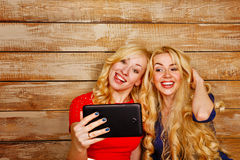 Sisters communicate in social networks, selfie Stock Photos