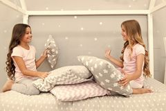 Sisters communication. Children relax and having fun in evening. Sisters leisure. Girls in cute pajamas spend time. Together in bedroom. Sisters communicate stock photos