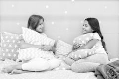 Sisters communication. Sisters communicate while relax in bedroom. Family time. Children relax and having fun in evening royalty free stock image