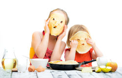 Sisters cooking pancakes Royalty Free Stock Image