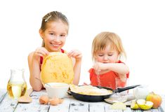 Sisters cooking pancakes Stock Photo