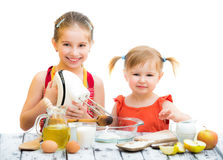 Sisters cooking Stock Photography