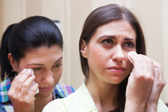 Sisters crying Royalty Free Stock Image