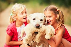 Sisters with dog. Stock Images