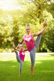 Sisters doing exercise outdoors. Healthy lifestyle Stock Photo