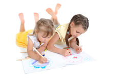 Sisters draw on the album. Royalty Free Stock Photography