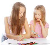 Sisters draw on the album royalty free stock photos