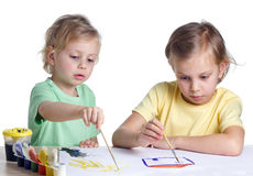 Two sisters painting Stock Image