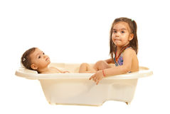 Sisters dreaming with open eyes in bath tub Stock Photos