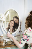 Sisters at dressing table Royalty Free Stock Photography