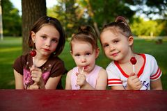 Sisters eating candy Royalty Free Stock Photo
