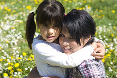 Sisters embracing. Two sisters embracing and smiling Stock Photography