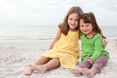 Sisters enjoy summer day at the beach. Royalty Free Stock Photo