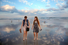 Sisters enjoying time  on beautiful beach. Royalty Free Stock Image