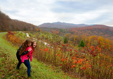 Sisters enjoying time together on fall hiking trip . Royalty Free Stock Photos