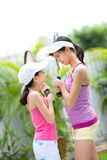 Sisters face to face before a game of tennis Royalty Free Stock Image