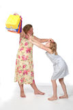 Sisters fighting over ball Royalty Free Stock Images