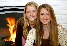 Sisters By The Fireside Stock Image