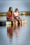Sisters fishing together Royalty Free Stock Photo
