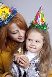 Sisters four and eighteen years old at birthday. Stock Image