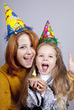 Sisters four and eighteen years old at birthday. Stock Photos