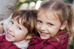 Sisters and friends. Portrait of two happy little girls smiling Stock Image