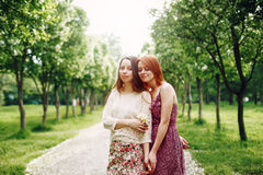 Sisters or Friends Outdoors in Summer Time Royalty Free Stock Photography