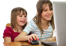 Sisters fun with laptop Stock Photography