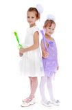 Sisters fun with magic wand Royalty Free Stock Photo