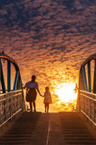 Sisters go back home at sunset brigde Royalty Free Stock Photos