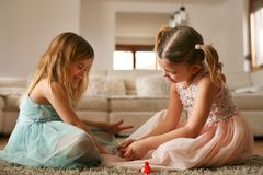 Sisters have fun together. Girls stuff. royalty free stock photography