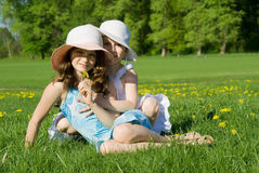 The sisters have a rest in the meadow Royalty Free Stock Photos