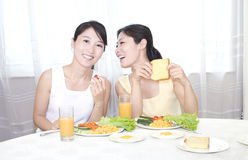 Sisters having breakfirst Stock Images