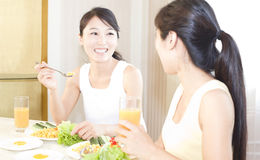 Sisters having breakfirst Stock Image