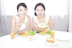 Sisters having breakfirst stock photo