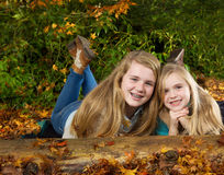 Sisters Having fun on an Autumn Day Stock Images