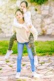 Sisters having fun outdoor. stock photos