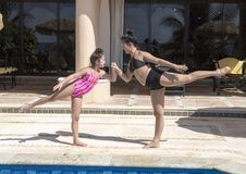Sisters having fun by the pool on vacation in Mexico royalty free stock image
