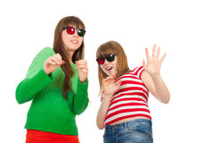 Sisters having fun while watching 3D movie. Isolated on white background Royalty Free Stock Photography