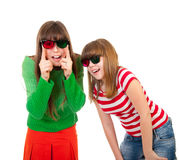 Sisters having fun while watching 3D movie Stock Images