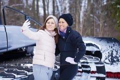 Sisters having selfie photo on ski resort Stock Image
