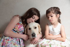 Sisters with her dog Royalty Free Stock Photo