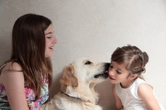 Sisters with her dog Royalty Free Stock Image