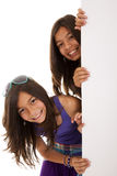 Sisters holding a blank billboard Royalty Free Stock Images