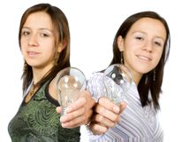 Sisters holding lightbulbs Stock Photo