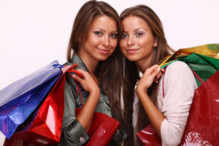 Sisters holding shopping bags on white isolated Royalty Free Stock Photography